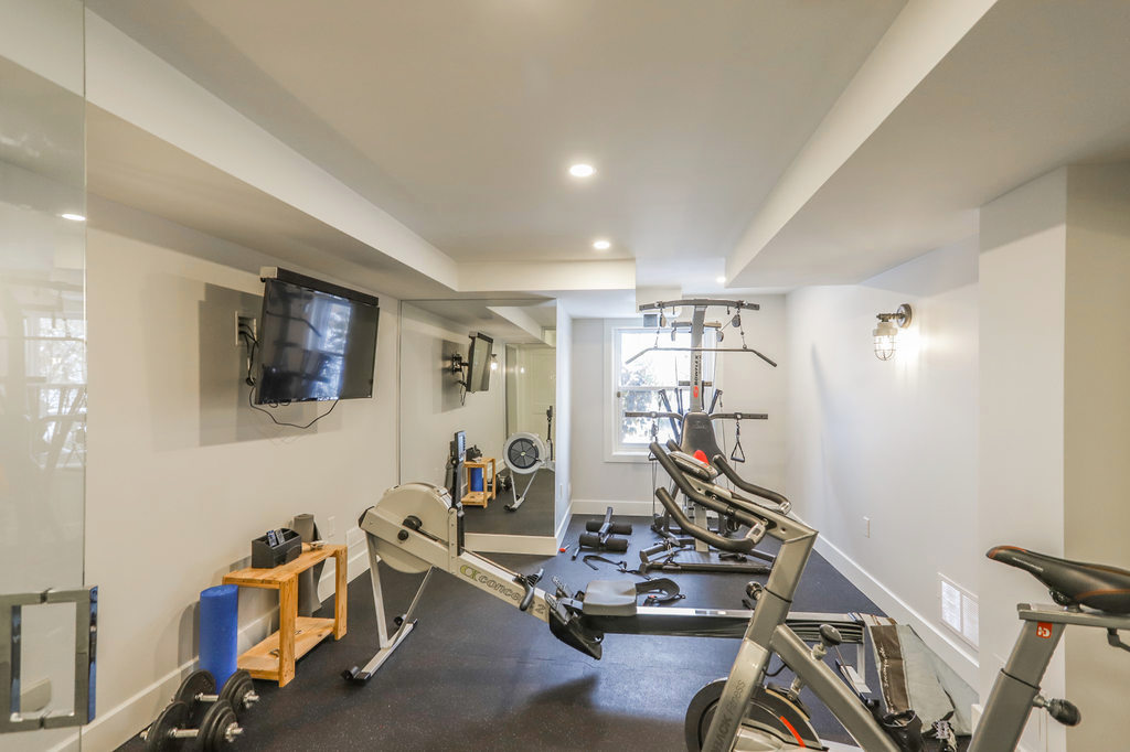 Gyms. Home renovation. A London Ontario design / construction project by Core Builders, a London Ontario home builder & home renovations contractor.